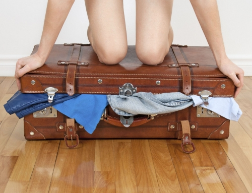 Med koffert på slep